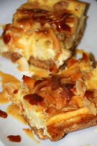 coconut caramel cheesecake bars baked and cut